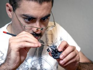 man painting miniatures