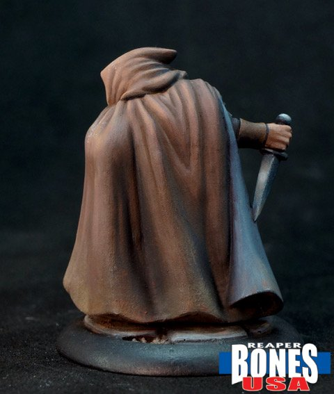 rear of painted thief figure